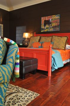 dark bedroom walls, full headboard in a fun color and a chair or lounge. great art too!