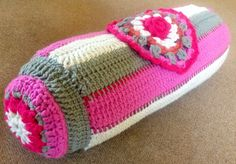 Bolster Cushion. Made with a mix of Tunisian crochet, ordinary crochet, and a knitted rosebud!
