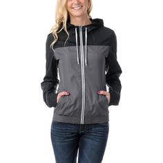 The girls windbreaker from Zine Girls is a cute lightweight jacket that will quickly become your go to jacket for summer. Featuring contrasting white zipper and hood drawstrings, a black and charcoal grey colorway, side hand pockets, and ribbed cuffs and bottom hem. This windbreaker shell will keep you warm, dry, and looking cool. The old school meets new cool with this girls windbreaker from Zine.