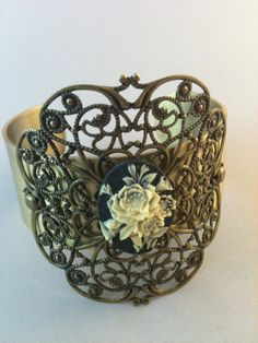 This beautiful cuff features antiqued brass scrollwork and a cream and black cameo. The bracelet is glued and bracketed for extra durablility. Steampunk Heart, Gothic Steampunk, Steampunk Fashion, Vintage Goth, Vintage Hipster, Hipster Goth, Post Apocalyptic Fashion, Fantasy Gowns, Cameo Jewelry