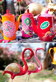 Wonderland party decor includes flamingos and hand-decorated tea pots