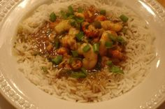 Shrimp and Crawfish Etouffee. Perfect for a Mardi Gras celebration! Shrimp and Crawfish Etouffee. A spicy gravy made from shrimp, crawfish, vegetables and lots of spices. A traditional Cajun dish served over rice. Creole Recipes, Cajun Recipes, Shrimp Recipes, Cajun Food, Rajun Cajun, Cajun Dishes, Seafood Dishes, Spicy Gravy, Mushroom Pork Chops