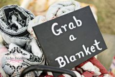 """Quilts for your guests to sit on or wrap up in on cold wedding days!!! Chalkboard sign reads, """"Grab a blanket."""" Fall wedding accents.  Country Fall Barn Wedding. Photographer: Andie Freeman Photography www.TheAthensWedd... Venue: The Barn on Belmont thebarnonbelmont.... Coordinating and Floral: Hydrangea House"""