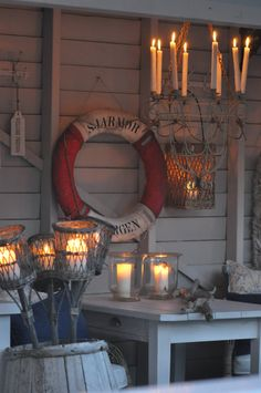 I want a fun chandelier for my covered deck!  Also love the tiki lights in the barrel.