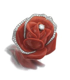 A gold, platinum, coral and diamond clip by Cartier, c.1960, in the form of a rosebud, symbol of blossoming love and beauty.