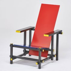 """Lot 1001  GERRIT REITVELD; CASSINA  Estimate: $800 - $1,000   """"Red Blue"""" chair, Italy 1980s; Stained, enameled wood; Manufacturer marks; 35"""" x 26"""" x 34"""""""