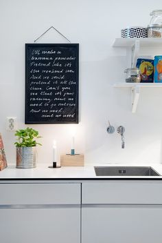 This Swedish apartment features historic architectural detailing mixed with a modern decor for an excitingly fresh interior filled with decorating ideas. Modern Kitchen Cabinets, Modern Kitchen Design, Interior Design Kitchen, Kitchen Decor, Kitchen Lyrics, Scandinavian Style, Cocinas Kitchen, Kitchen Photos, Home Kitchens