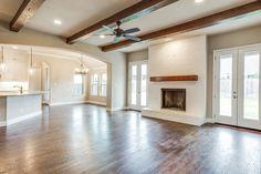 Painted Brick Fireplace. Cedar Beam. Wood Beams in Living Room. French Doors. Bannister Custom Homes.