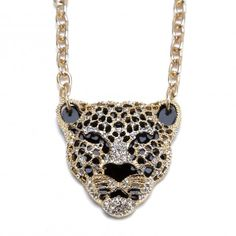 """This fierce feline is spotlight ready! Shiny goldtone jungle cat pendant casting with black enamel on a black acrylic back and sparkling crystal pave stones. The necklace is 25"""" long and has a 3"""" extender. The pendant itself is about 2.25"""" x 2"""". Necklace closes with a lobster claw clasp. $24.99"""