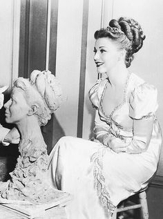 Ginger Rogers as Dolly Madison posing for a bust while filming MAGNIFICENT DOLL
