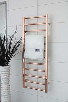Love the mix of square and round rods that make up this gorgeous rose gold heated towel rail. DC Short Cubo E Heated Towel Rail (AUS) Gold Bathroom, Bathroom Towels, Bathroom Interior, Bathroom Shelves, Shiplap Bathroom, Bathroom Doors, Décoration Rose Gold, Rose Gold Decor, Gold Bad