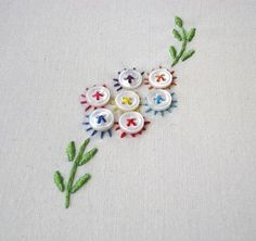 I <3 this. These button flowers are adorable and I can picture a little white dress (for a little baby girl) with this embroidered at the bottom :)