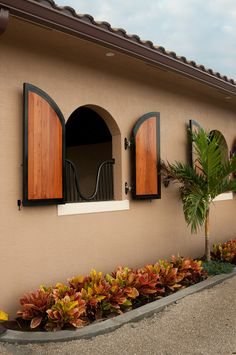 Equine barns stables on pinterest horse barns stables for Spanish style shutters