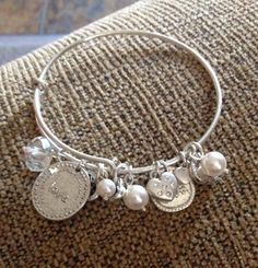 "Our ""Sentimental"" bracelet is adorable!  Love all the charms and it's adjustable!"
