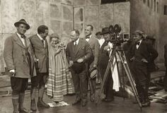 From left to right: Gunther Rittau, Fritz Lang, Brigitte Helm, Samuel Rothapfel, Unknow, and Karl Freund on the set of Metropolis.