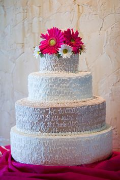Song Lyrics on your Wedding Cake---this is Awesome!!! It could be you and Andrew's song...and if you go with the Gerber daisies for the bridal party you could use coral flowers on top