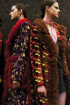 Multi-coloured, scale print coats with fur lining at Prada AW14 MFW. More images at: http://www.dazeddigital.com/fashionweek/womenswear/aw14