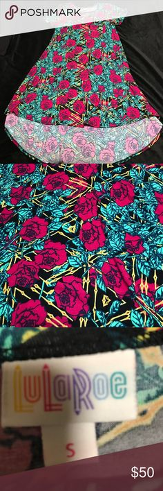 LuLaRoe Carly Sz Small Size small LuLaRoe Carly Dress/Shirt. Worn and washed once per LLR instructions. No defects. Dark pink roses and green leaves on black with yellow design background. Stunning. Little too tight on my chest which is 38b. Make an offer! LuLaRoe Tops
