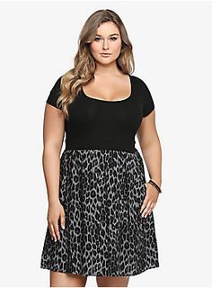 "We're pretty wild about this look. A black form-fitting bodice meets a black and grey animal print bottom to make one fashionable dress. Side pockets give this frock laid-back appeal. It's a put-together style that only needs you to put it on and go.<ul><li> Size 1 measures 41"" from shoulder</li><li>Cotton/spandex/rayon</li><li>Wash cold, dry flat</li><li>Imported</li></ul>"