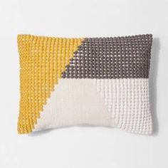 Add a bold touch of style to any living space in your home with this Texture Colorblock Lumbar Pillow from Project 62™. This unique lumbar throw pillow has a woven pattern in two different textures that creates multiple colorblock sections for a bold look. This textured lumbar pillow is designed with a knife edge to help it retain its shape during use. Simply toss this stylish colorblock lumbar pillow on your sofa or armchair to add a fun pop of texture to your living space.<br>...