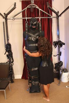 The suspension frame in action at the dungeon of Ms Troy Orleans of NYC: Salon d'Orleans. www.troyorleans.com