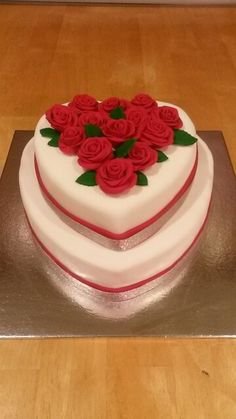 Rose heart cake.  Chocolate cake with chocolate buttercream filling covered with fondant