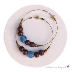 Ethnic chic earrings - Statement hoops. Bronze steel rings, sienna ceramic and blue recycled glass beads.  © Natacha Fayard  #boho #ethnic #chic #earrings #jewelry #hoops #rings #bronze #sienna #blue #ceramic #recycled #glass