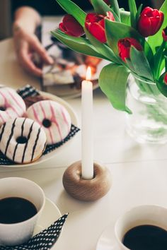 Donut - Laura Väre Donut is a small and simple candlestick which brings smiles on your guests faces around the coffee table. It looks like a plain donut, until the stearine slowly drips on it, making it look like icing on the so-called pastry.