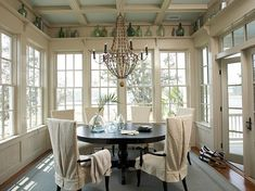 Windows all around, beautiful chandelier, and old world bottles.