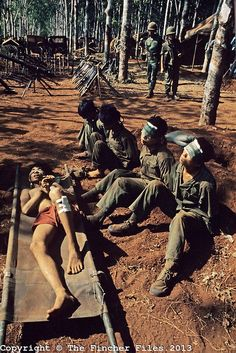 Injured and blind-folded North Vietnamese prisoners seen near Xuan Loc, Vietnam.1975. Photograph by Terry Fincher
