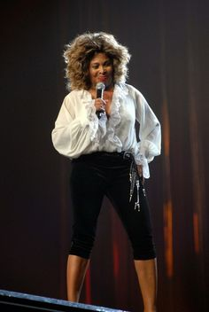 Tina Turner performs at the Jobing.com Arena in Glendale Arizona ...