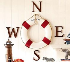 Idea from #Potterybarn Kids. Life preserver with large letters beside it to show your bearings as on a compass, N, S,E and W. Great for a #nautical themed room!
