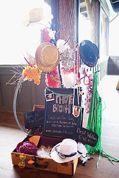 photobooth props - we could have some froufrou floral hats, leis, big paper flowers to hold....