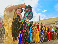 Dancing Kurdish Girls in beautiful traditional colorful Dresses.