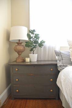Dark gray rustic nightstands with gold hardware.