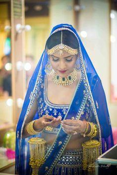 Bridal Portrait - Royal Blue Wedding Lehenga with Golden Jewelry and Golden Kaleere  #wedmegood #indianbride #indianwedding #bridal #goldenjewelry #goldjewelry #kaleere