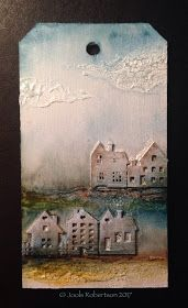 Adhere the house embellishments and the apply a coat of Crackle Paint to an MDF Tag Apply Crackle Paste with a palette knife to fo...