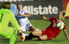 Carli Lloyd and Switzerland's Lara Dickenmann. (Travis Long/The News & Observer)