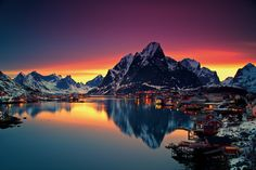 midnight-sun-in-lofoten-norway. Reine is a small Norwegian fishing village nestled in the Lofoten Archipelago, a picturesque string of islands within the Arctic Circle. Lofoten, Beautiful Norway, Beautiful World, Beautiful Places, Amazing Places, Beautiful Sunset, Amazing Photos, Beautiful Scenery, Wonderful Places