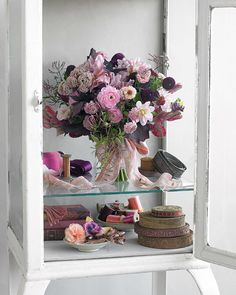 A bundle of jasmine, zinnias, sedum, and ranunculus looks fresh and wild, as though each blossom was hand-picked from your grandmother's garden.