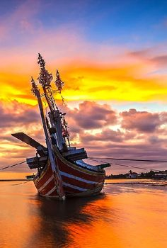 A boat and Goldy Sky by Budi Astawa on Web