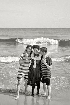 Coney Island, New York, circa 1905. Two strings to her beaux