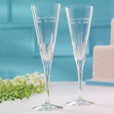 Wedding Toasting Flutes. Duchesse - These trumpet style champagne flutes from Vera Wang boast confident and sleek styling with clean lines and etchings. From Exclusively Weddings. | #exclusivelyweddings