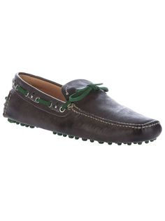 Grey nappa leather shoes from Car Shoe featuring a moccasin design, a stitched seam detail to the front, a green bow to the top, a green lace detail at the rim at the rim weaved through silver-tone metal loops and a textured rubber sole that extends to the back.