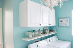 laundry room with chandelier. beautiful color for a laundry room.