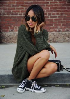 olive green Anine Bing cardi, black high-top Converse sneakers