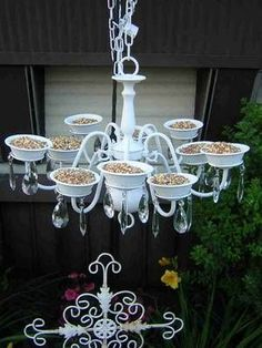 old chandelier painted and used as a bird feeder