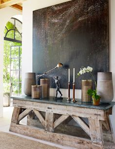 .lo rustico , con el toque sofisticado de las ventanas, la altura y materiales nobles