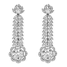 "Belle Époque diamond ""feather"" drop earrings, suspending two larger old mine cut diamonds weighing approximately 2.43 carats and 2.35 carats, respectively, mounted in platinum, circa 1915."
