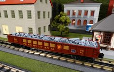 MTH Spotlight http://mthtrains.com/railking/spotlight/08_2015/f In the freight yard today the just arrived MTH RailKing O Gauge Gondola with Junk Load. These colorful Norfolk Southern Heritage inspired RailKing Gondolas come in Pennsylvania 30-72160, New York Central 30-72161, Norfolk & Western 30-72158